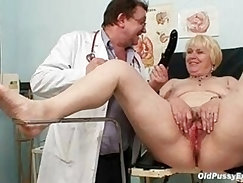 blond mom with a hairy pussy plays with cock