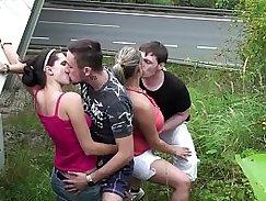 Hot busty porn model in a threesome gangbang