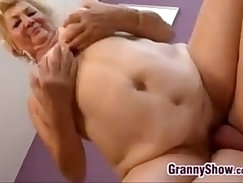 black granny with a charming smile on faces fucking