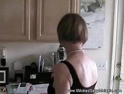 Brunette MILF playing with a big cumshot