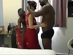 A guy joins a wife in a blindfolded threesome