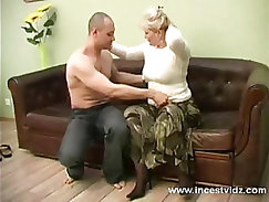 blonde mom and her young guy on sofa