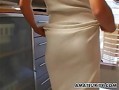 Amateur MILF fucked in a kitchen