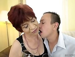 Beautiful woman is pleasuring young dude with harsh rough footjob