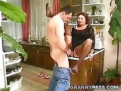 Cheating granny controls her hairy pussy